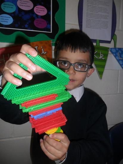 Making a house using stickle bricks.