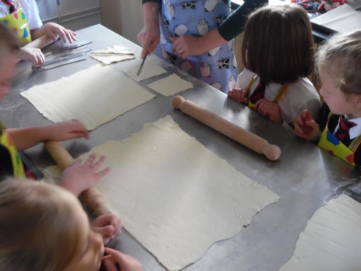 Cutting triangular shapes to form the croissant
