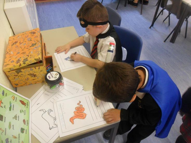 We have superhero capes and masks for writing.