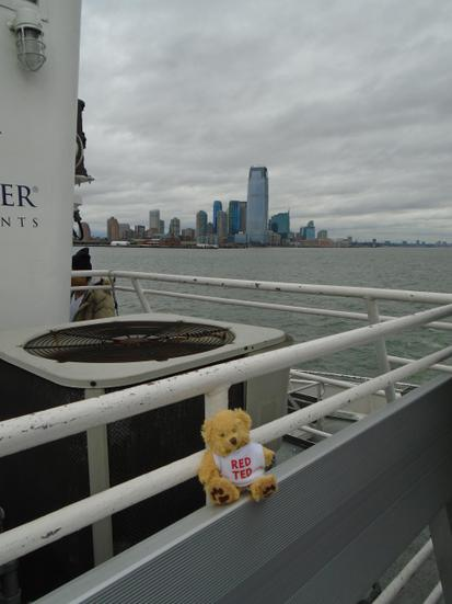 Taking a ferry to see a famous USA landmark.