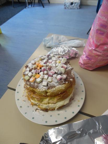 Miss Lena made us an amazing 3-tiered cream cake
