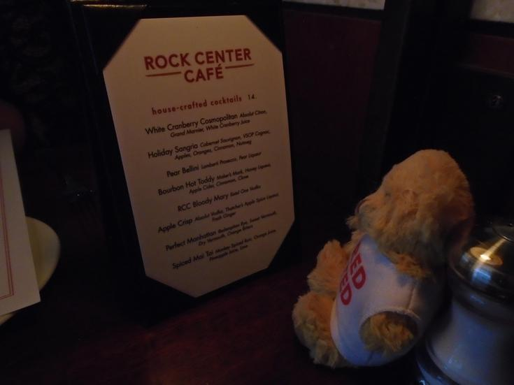 Red Ted is using his skills to read the menu.
