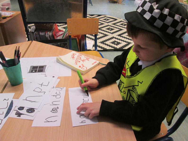 Applying our phonics] knowledge to create labels for our Police Station