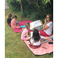 Reading in the shade with Mrs Taylor.
