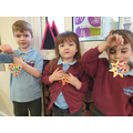 We had great fun fingerpainting decorations, we used rainbow colours to remind us of 2020.