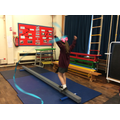 Evie on the balance beam using a ribbon