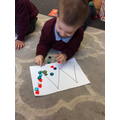 Developing our hand eye coordination and fine motor skills.