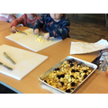 Developing our fine motor skills by cutting the ingredients for our Gruffalo crumble