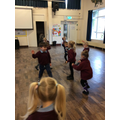 Creating dinosaur moves to music!