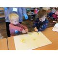 Carefully cutting apples to make Gruffalo Crumble...yummy!