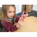 Carefully counting objects with 1:1 correspondence.