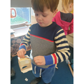 Developing our fine motor skills with tying knots.