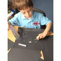 We strengthen our fine motor skills by peeling the stickers.