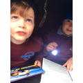 We love using our torches to read in the dark!