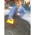 Developing our hand eye coordination by cutting, scooping and scraping the jelly.