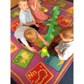 We programmed the beebot to climb the beanstalk