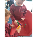 Developing our fine motor skills as well as our understanding of time.