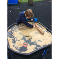 Exploring wet sand to build with.