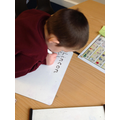 We are practising how to write our name