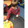 We used loose parts to create our own poppy.