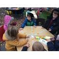 Playing a game to consolidate on sounds learnt in phonics, as well as promoting turn takin