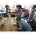 Samuel and Sam showing good team work in maths