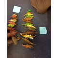 Ordering dinosaurs by size and writing labels!
