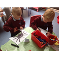 We carefully coloured and cut out spiders