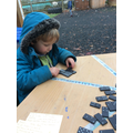 In maths we have been using the dominos to find 1 more and 1 less than a number to 5.