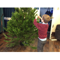 We decorated our Christmas tree with decorations made at forest school.