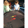 We worked together to roll the marbles through the paint to make firework pictures.