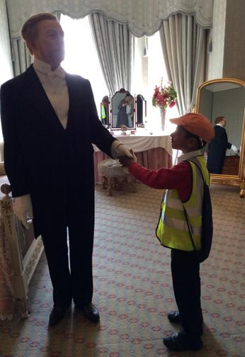 Shaking hands with the waxworks