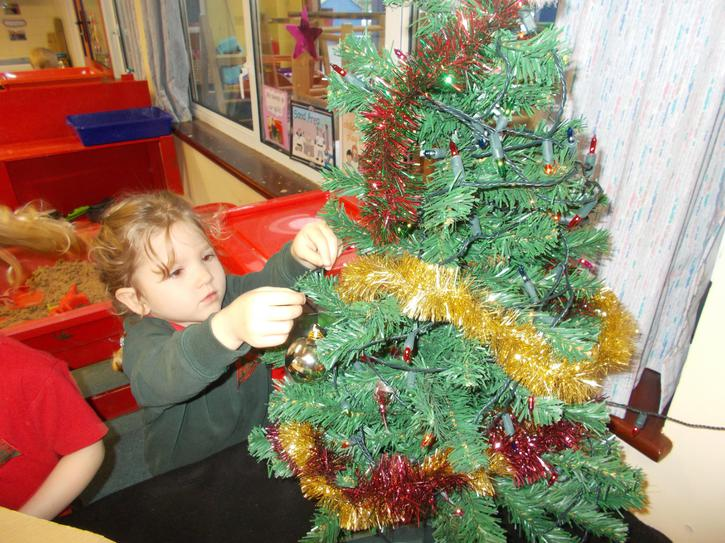 Decorating our class Christmas tree