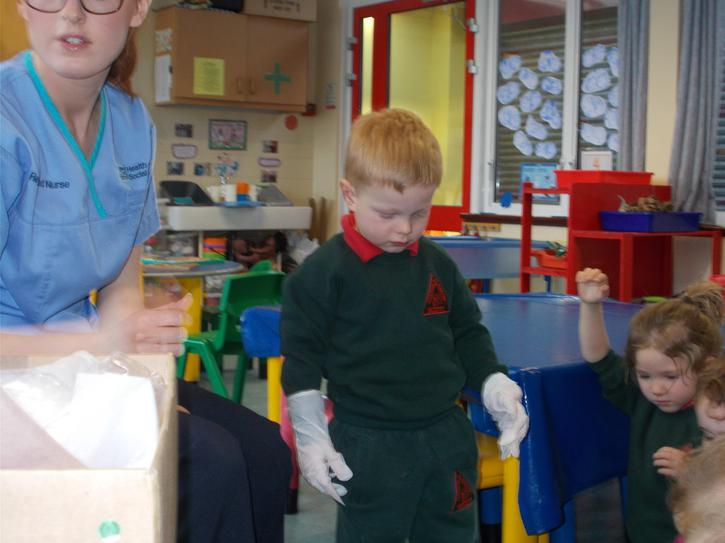 Wearing gloves to keep our hands clean