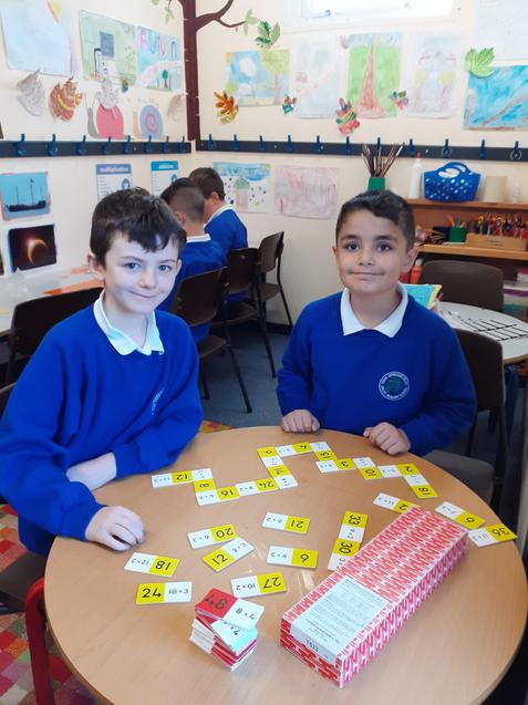 Maths dominoes help us develop our division skills.