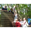 Scaling the wall of the Challenge Course as a team