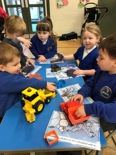 Nursery children with play dough