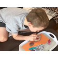 L has been busy painting rocks