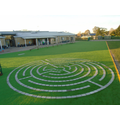 New artifical turf play area with our labyrinth