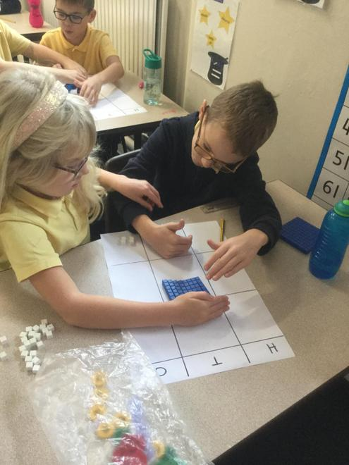 Learning the column method with manipulatives.