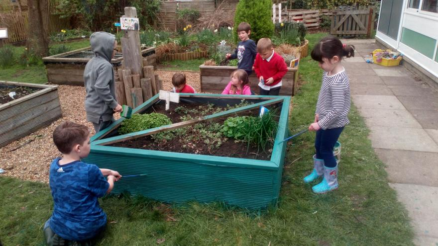 The children worked together to paint the planters