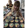 Reading a recipe to bake Rainbow cupcakes!