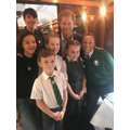 Prince Harry happy to join the group for a photo