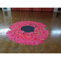 Single poppies were laid to form a large poppy