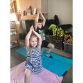 Austin and Tess doing yoga