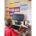 Jacob working hard on the computer
