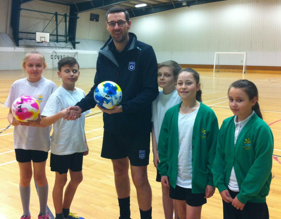Presenting a football to Mr Harvey, Kirkby High