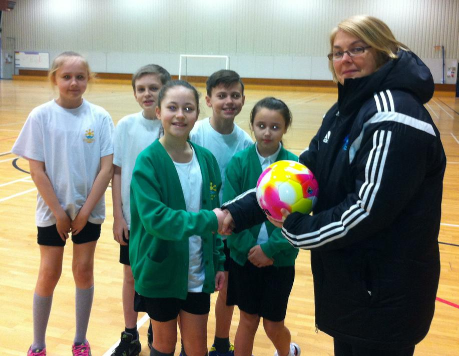 Presenting a football to Kerstine Hogg (KSSP)