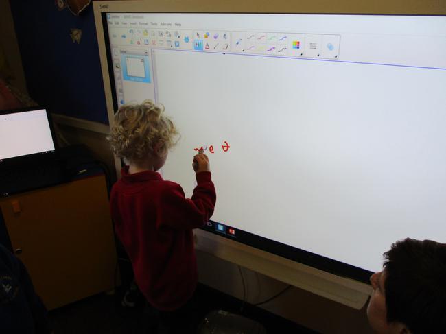 Mark making on the smart board.