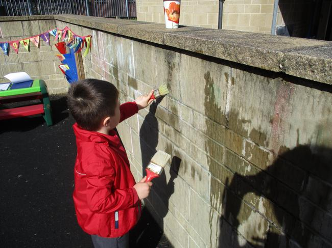 Mark making with water and paint brushes!